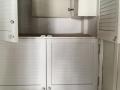 bergkast met zekeringkast en wasmachine aansluiting